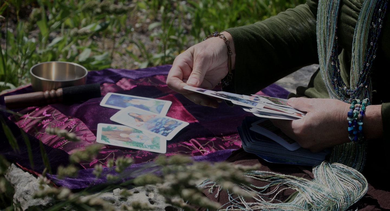 Joanna reading Gaian Tarot cards