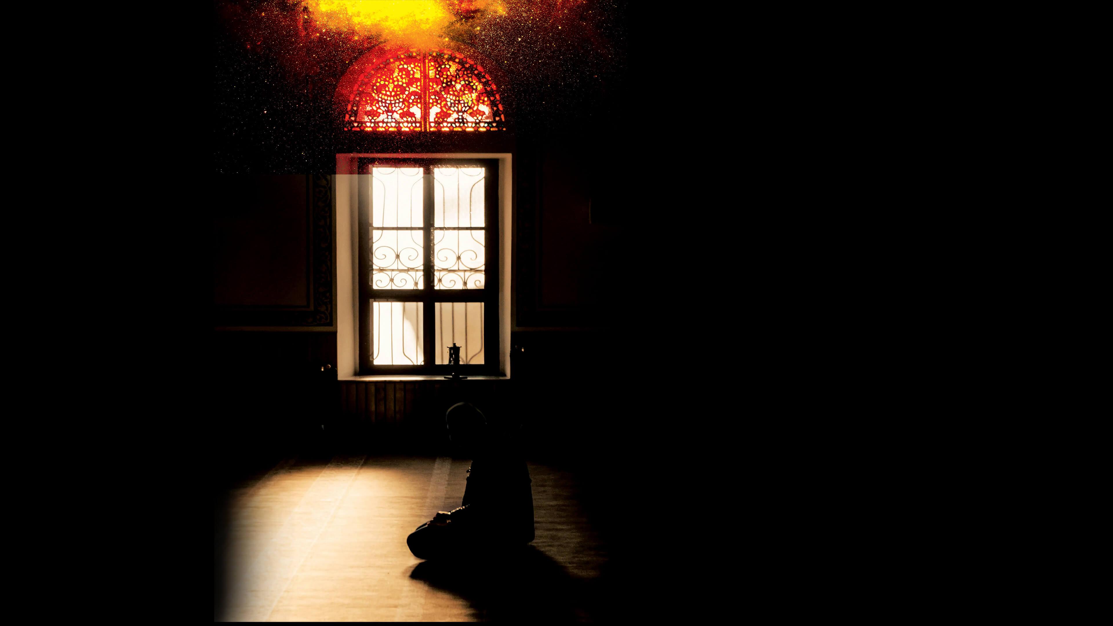 silhouette of Muslim man praying in masjid