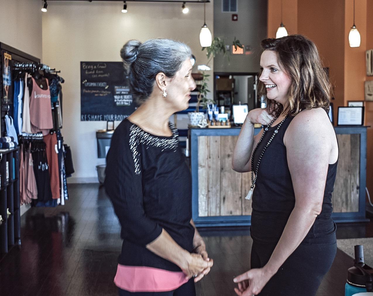 yoga student and yoga teacher