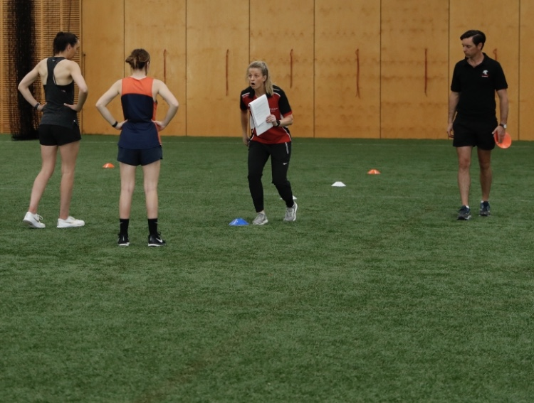 Image: Brooke Patterson working on ACL Injury Prevention with AFLW athletes
