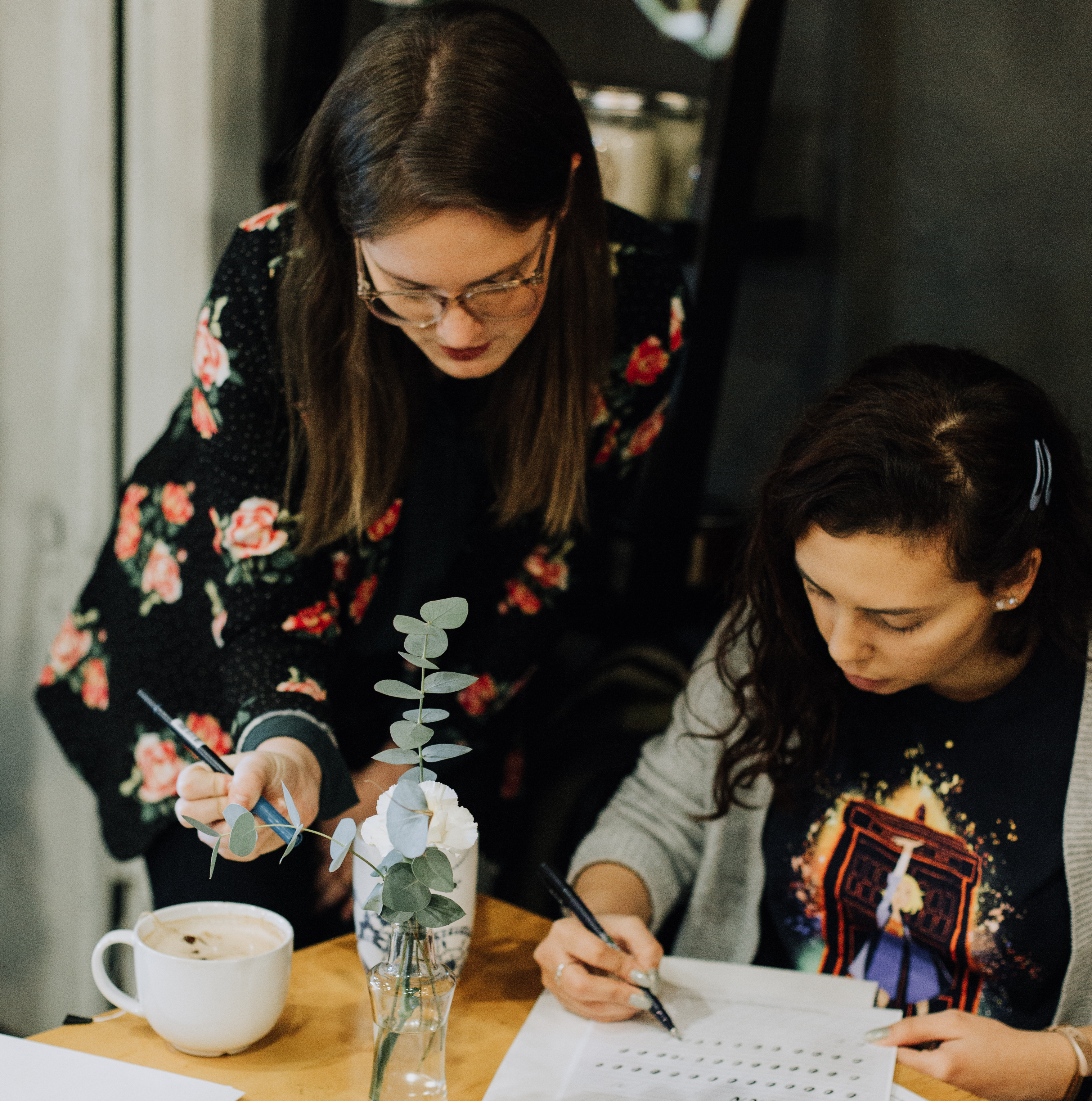 Calligraphy Instructor and student in workshop