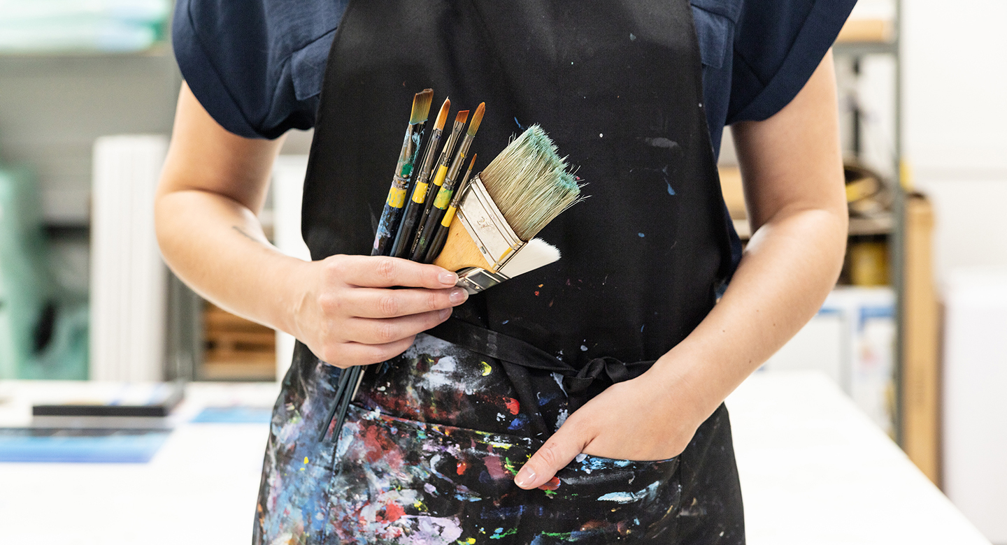 Artist and paintbrushes