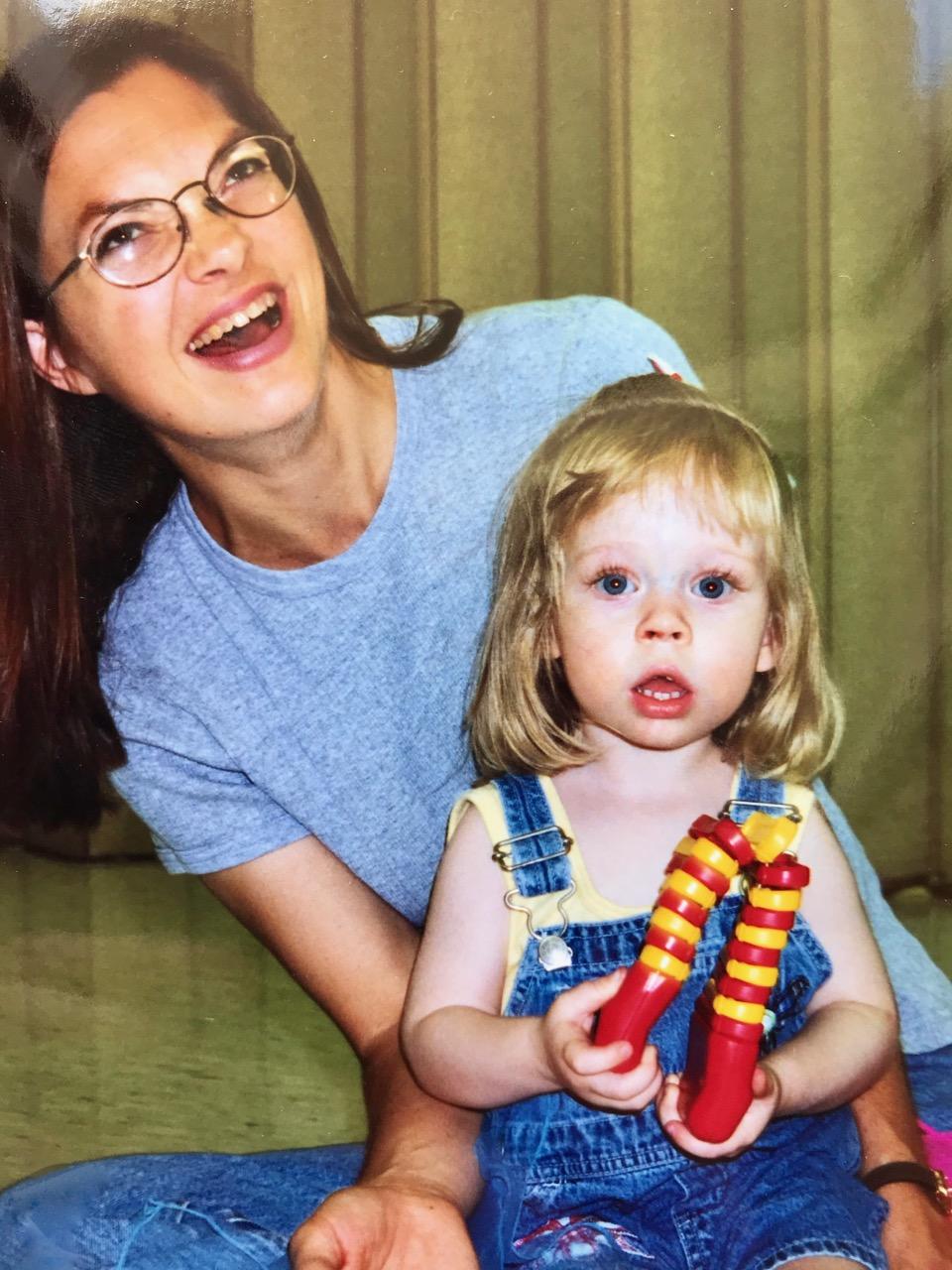 image of Kristin Shaeffer teaching music to a toddler.