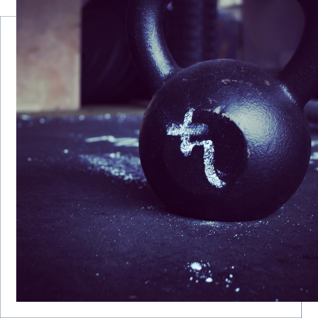 Kettlebell with a Saturn glyph drawn on it in lifting chalk