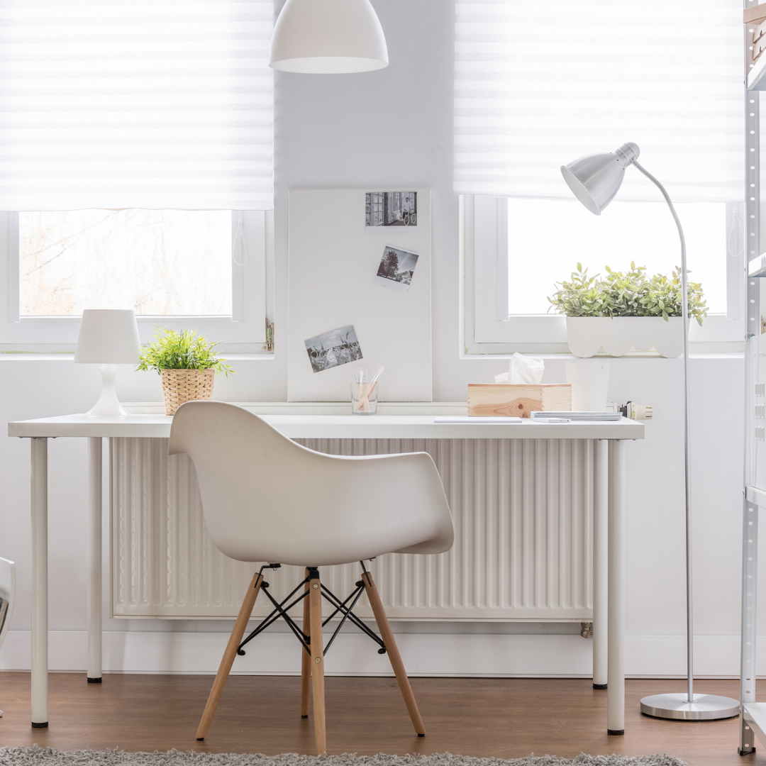white chair, desk, walls, lamp with green plant, minimalistic