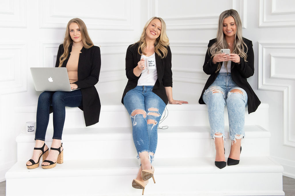 Three women sitting on steps