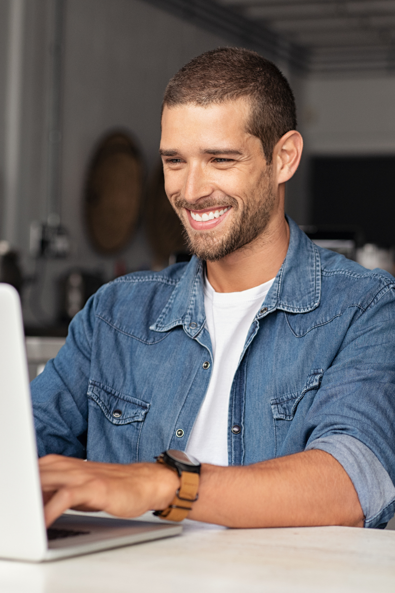 New business owners sitting at laptop ready to make money after completing WooCommerce course