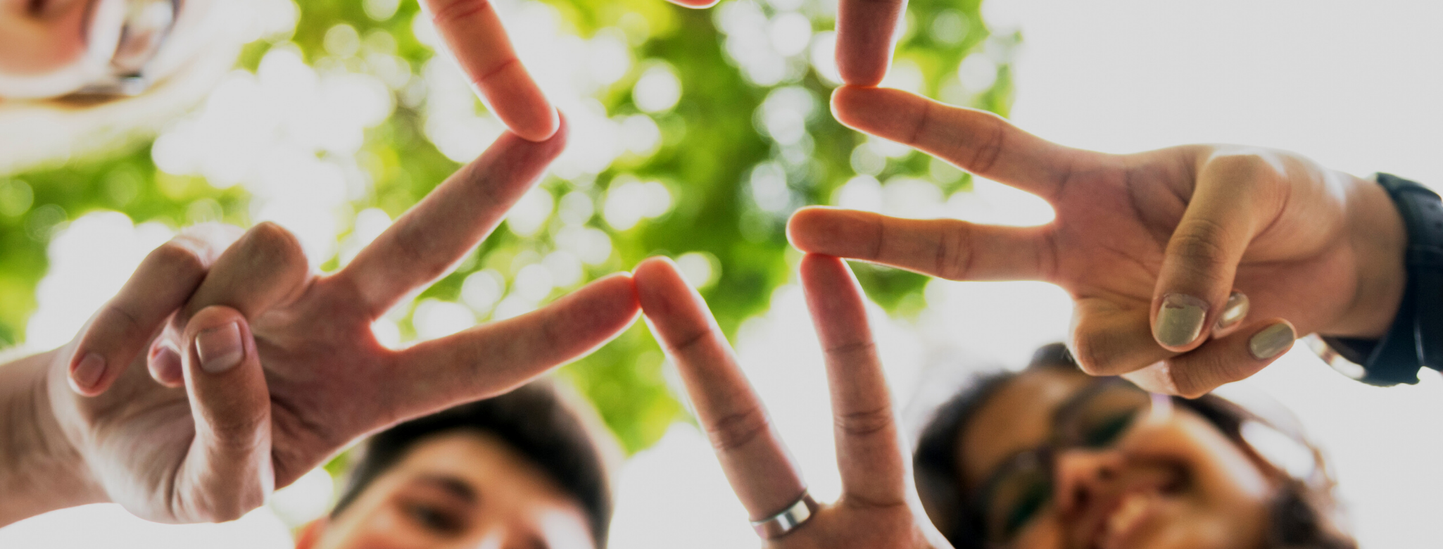 teens making peace signs with their fingers