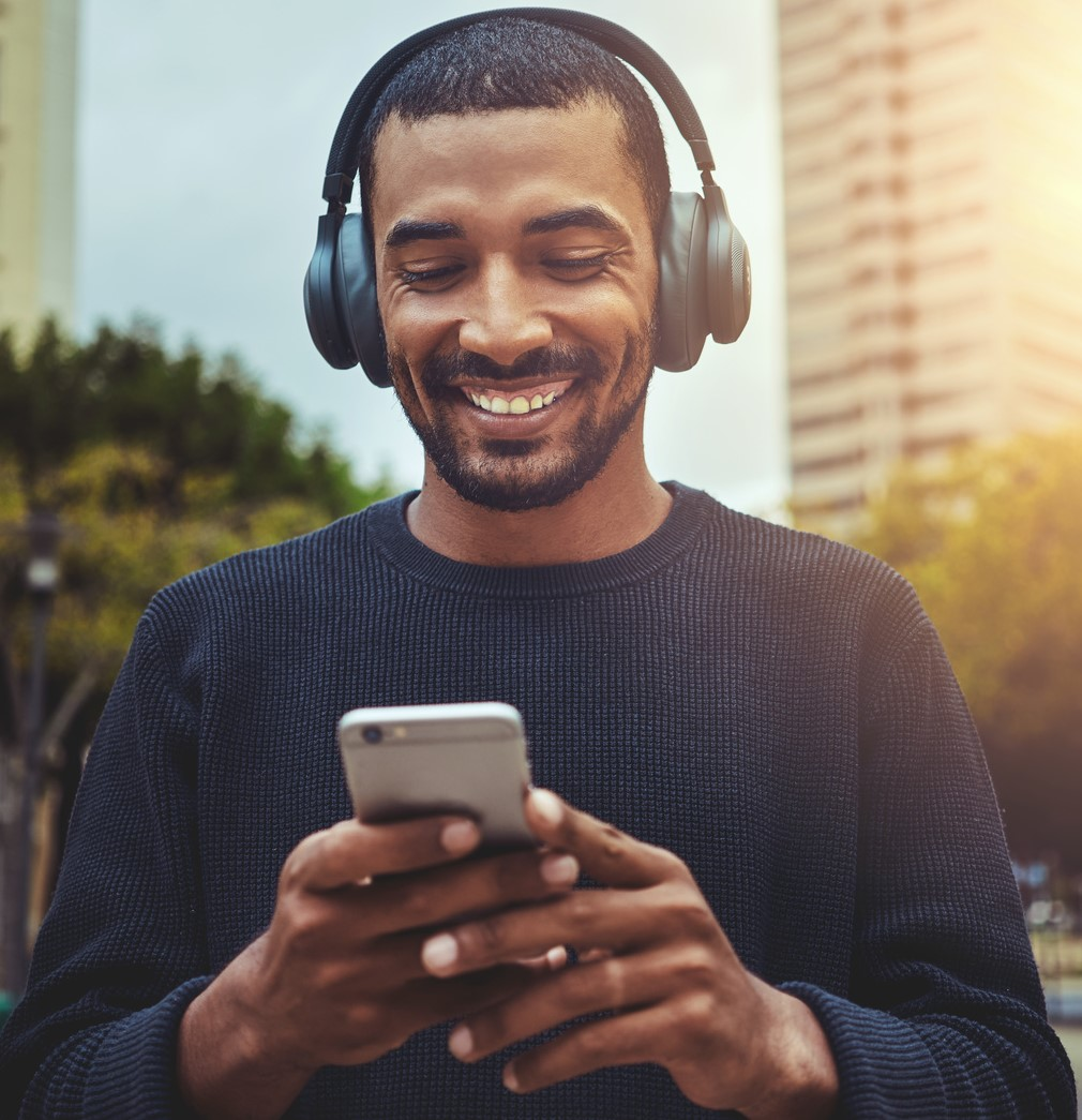 Man with phone and headphones