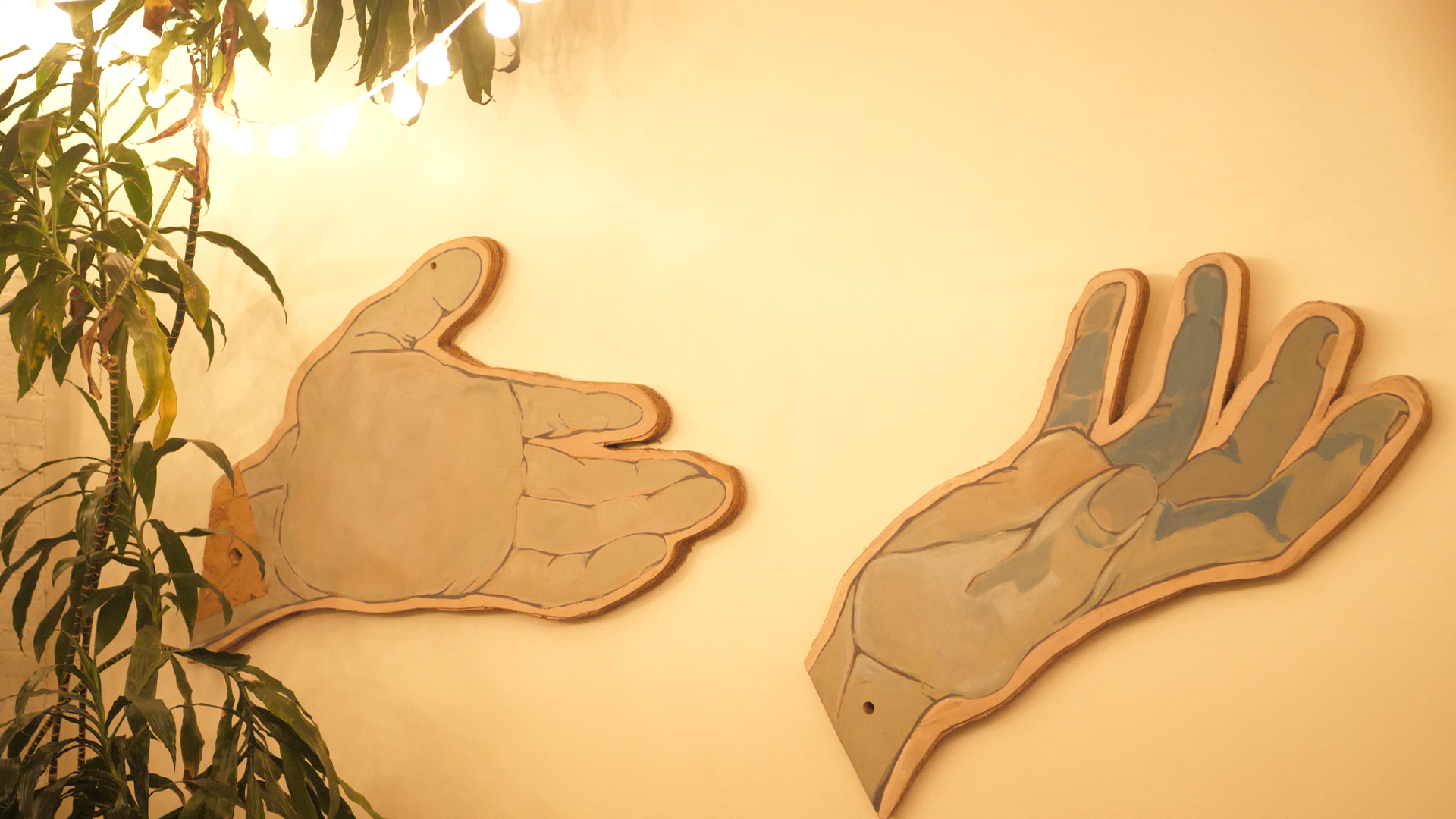 Decorative hands on a wall