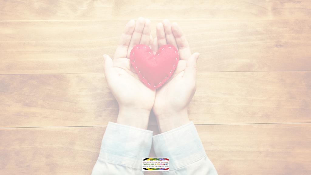 heart holding a hand