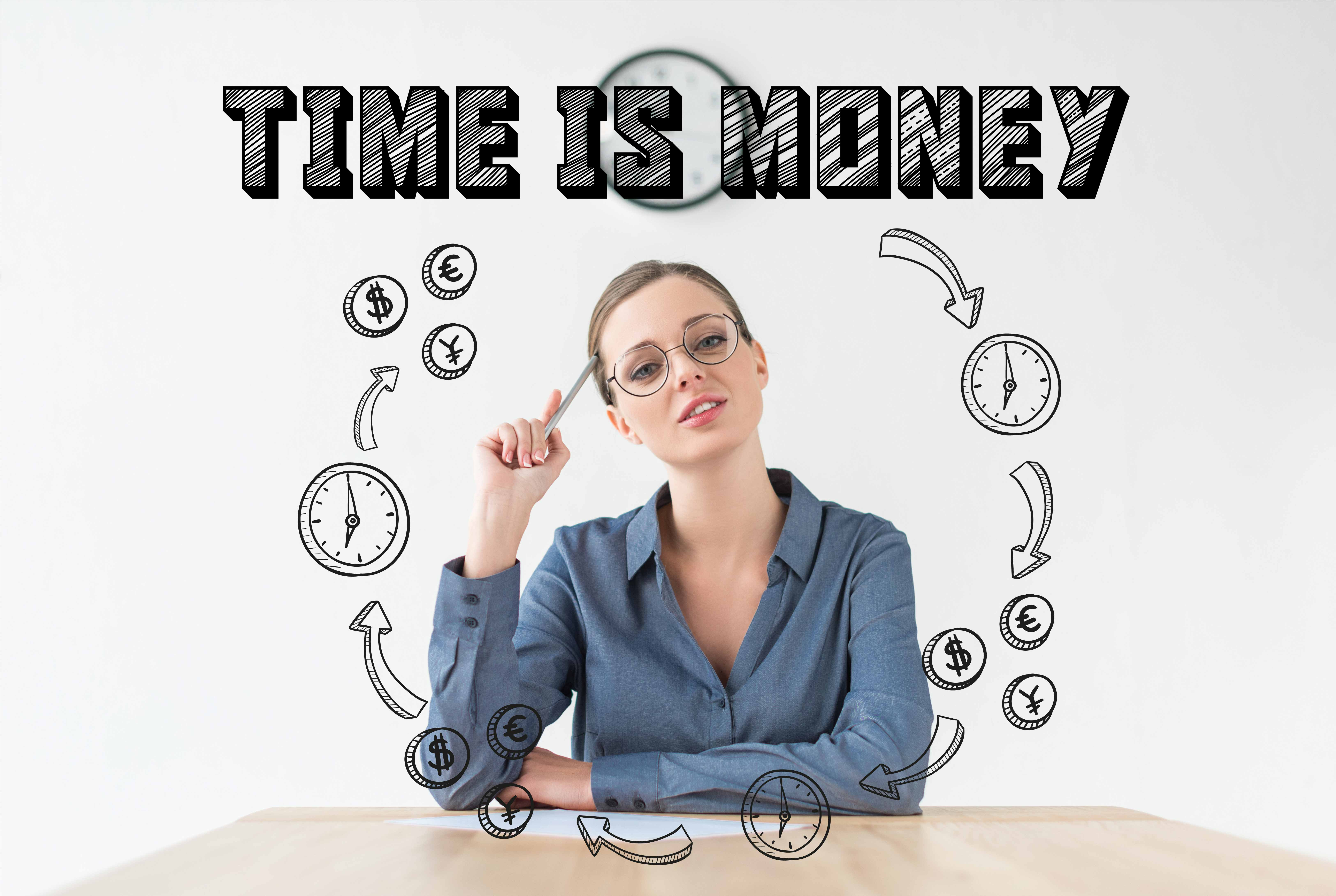 Business woman sitting at desk surrounded by icons of clocks and money symbols with the words time is money above her head.