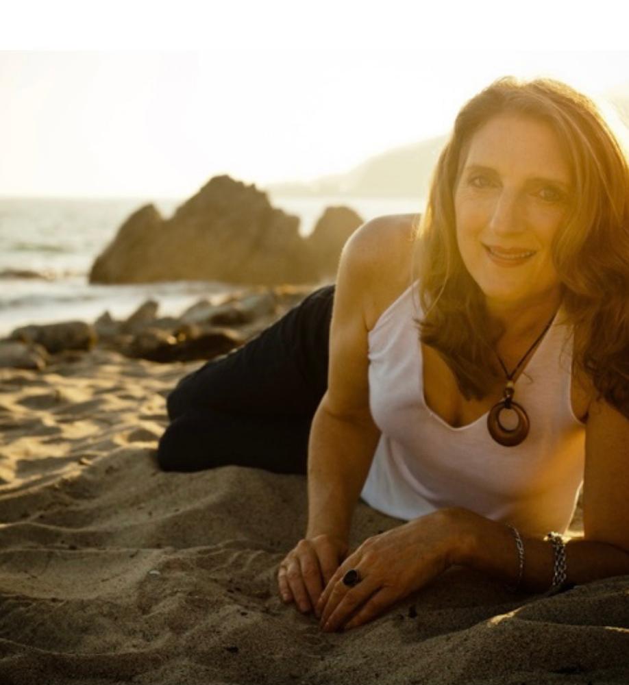 sharon otness posing at the beach
