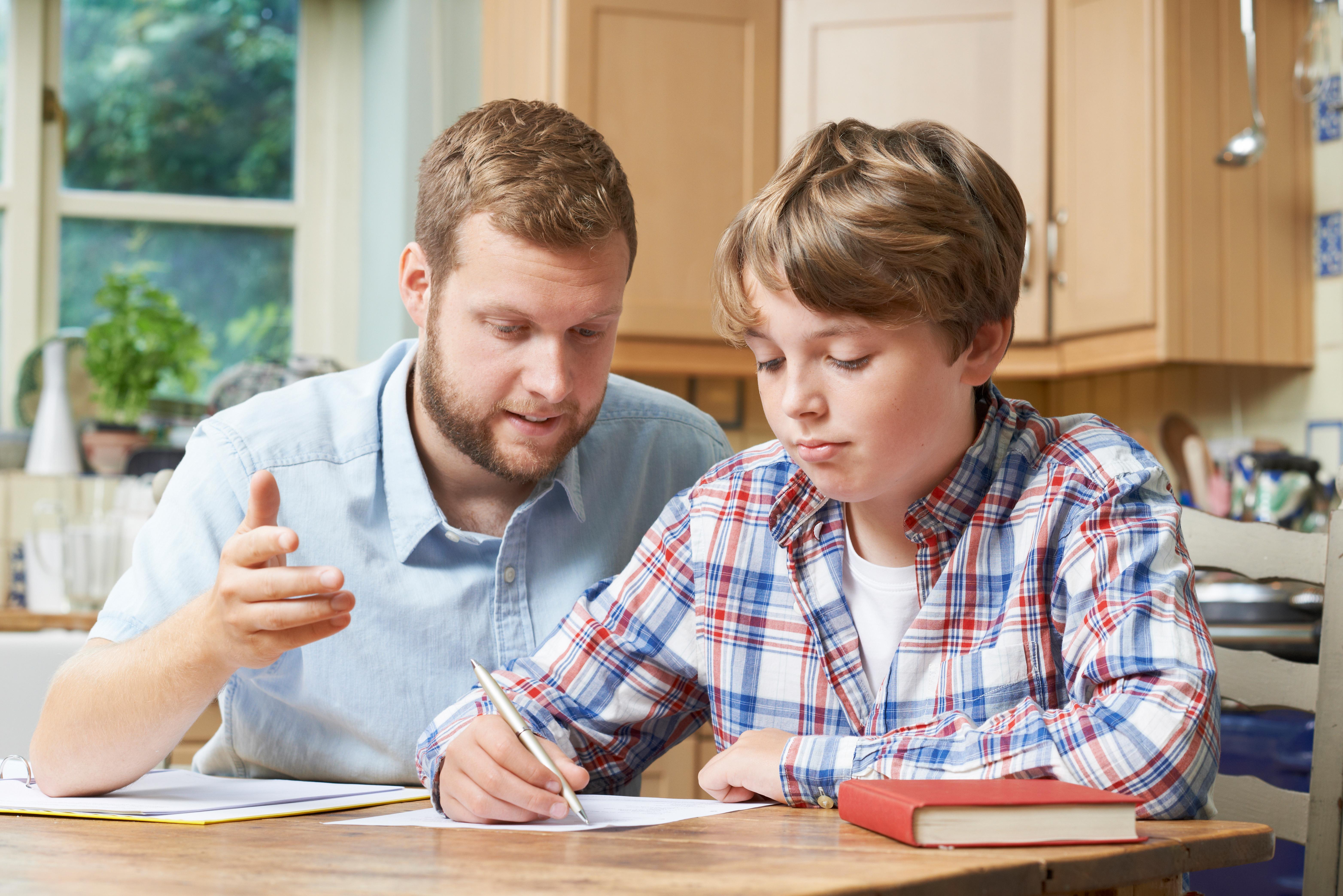 dad teaching son dad tutoring son homeschooling