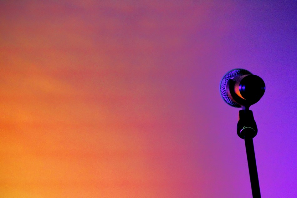 black microphone with orange & purple background
