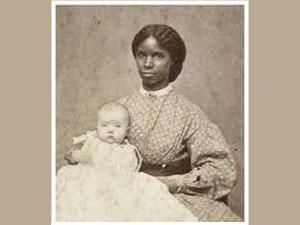 Photo of black slave wetnurse with white baby