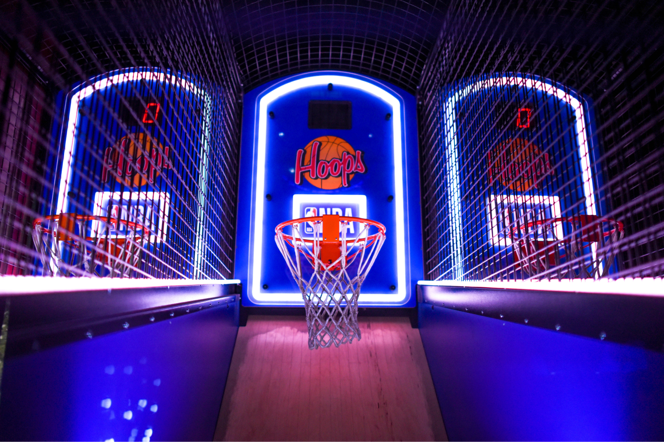 Basketball hoops game in an arcade. The middle hoop is lit up.