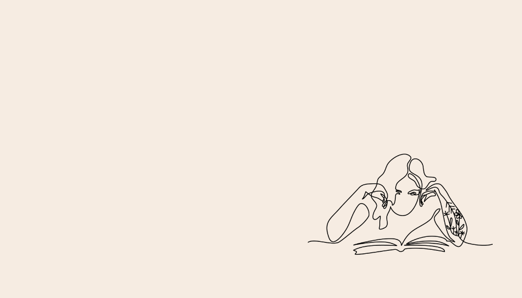 A girl in line art leans on a desk, reading her book - her floral tattoos climb her arm