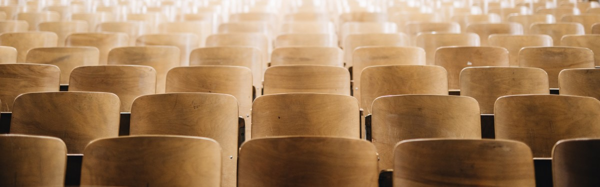 rows of wooden conference chairs