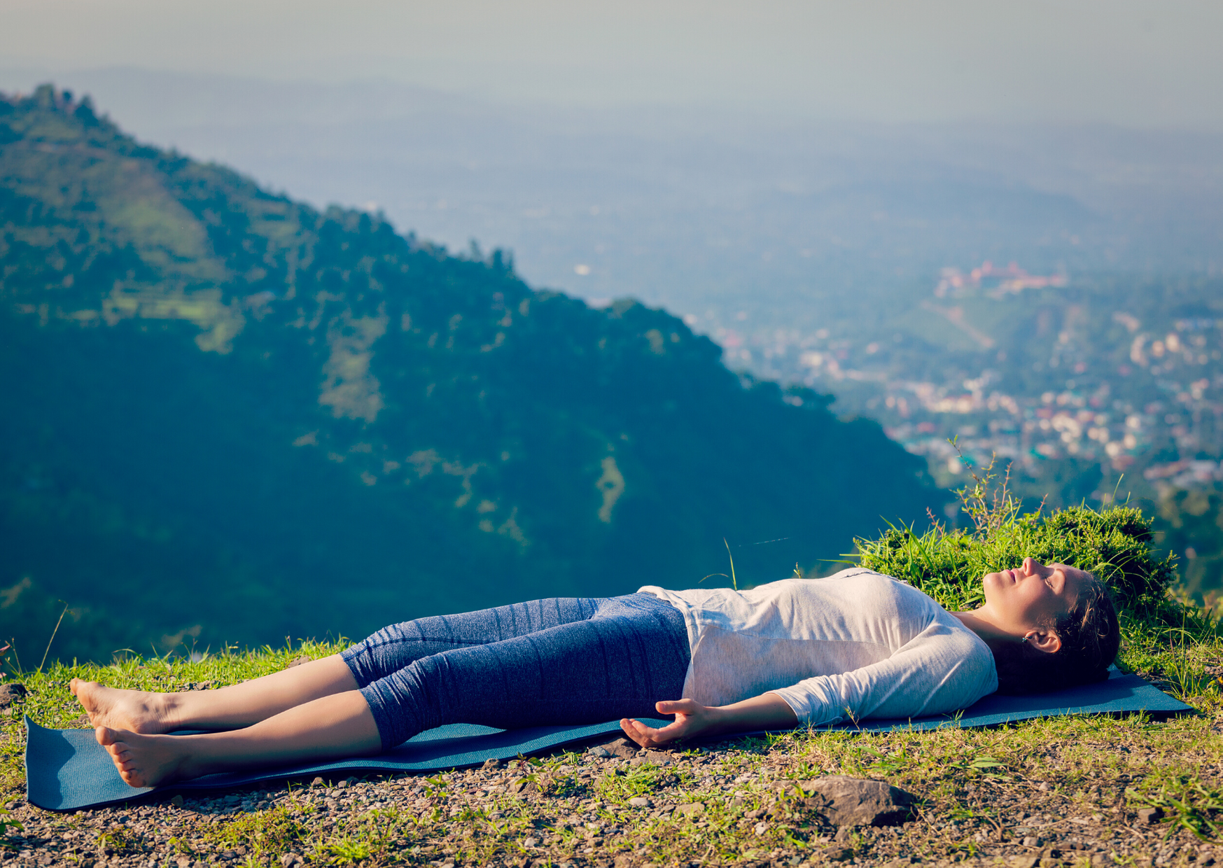 Women relaxes in savasana after yoga