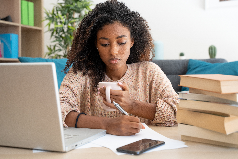 Nakhti University girl doing homework on laptop