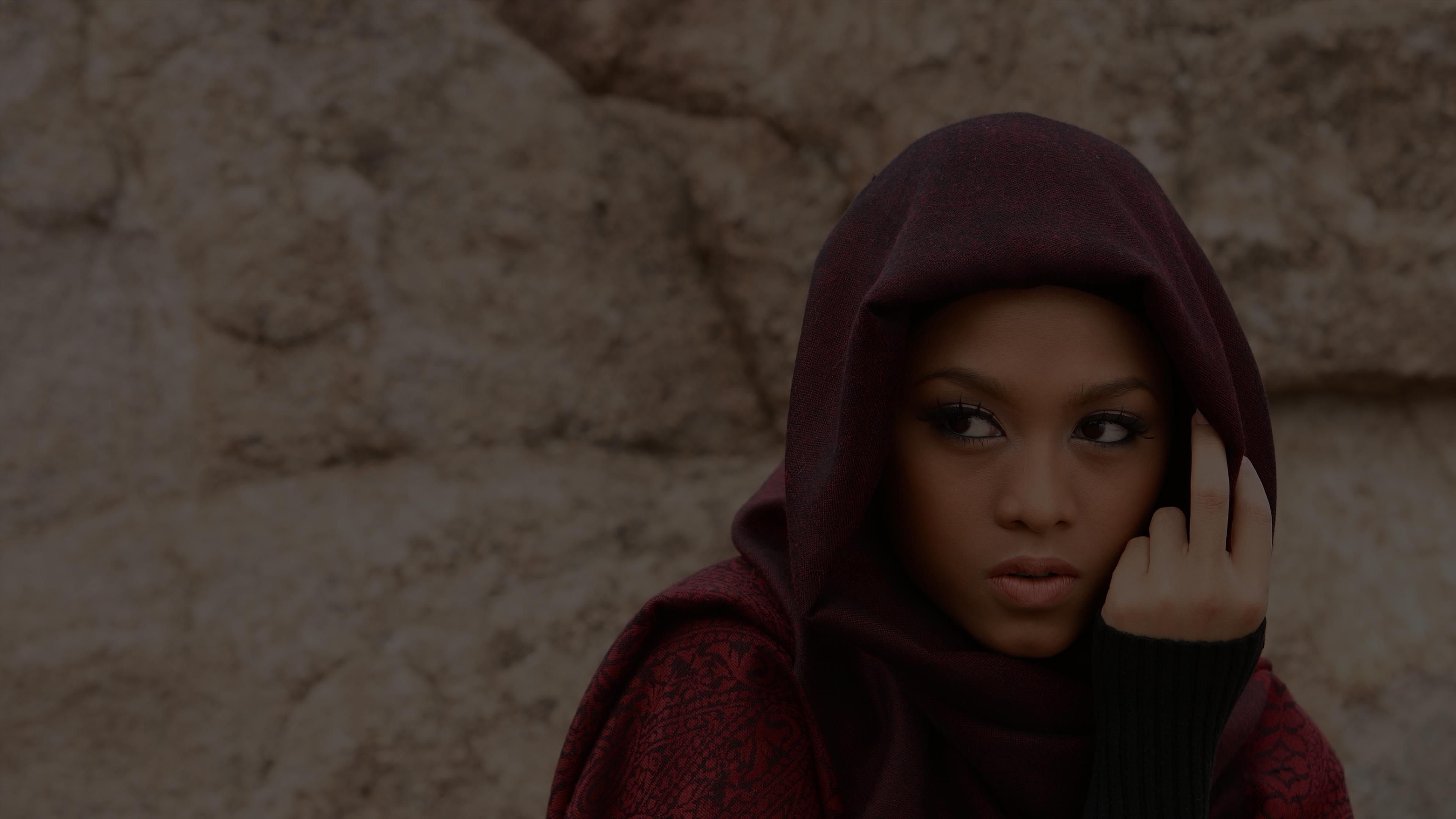Photo of woman in maroon hijab