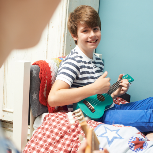 boy with blue ukulele