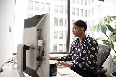 Black woman at a computer