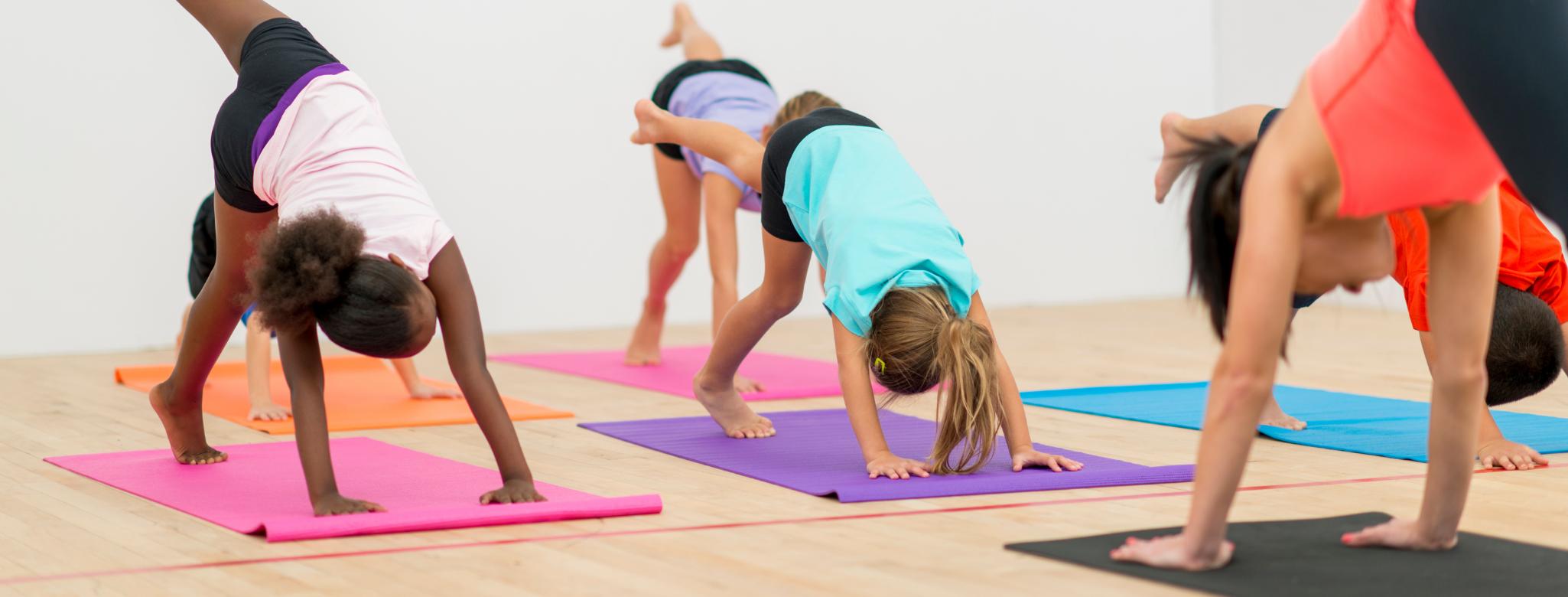 children practicing yoga on yoga mats