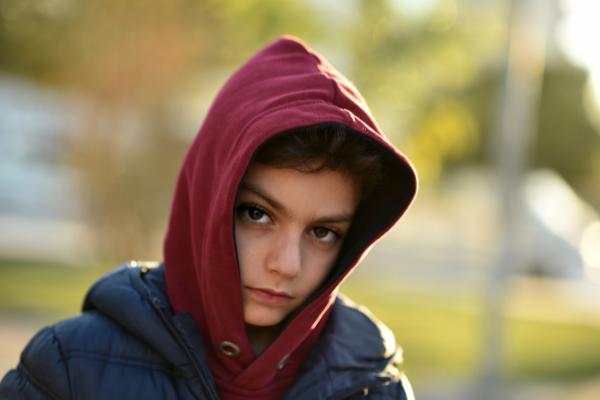 boy in hoodie looking worried