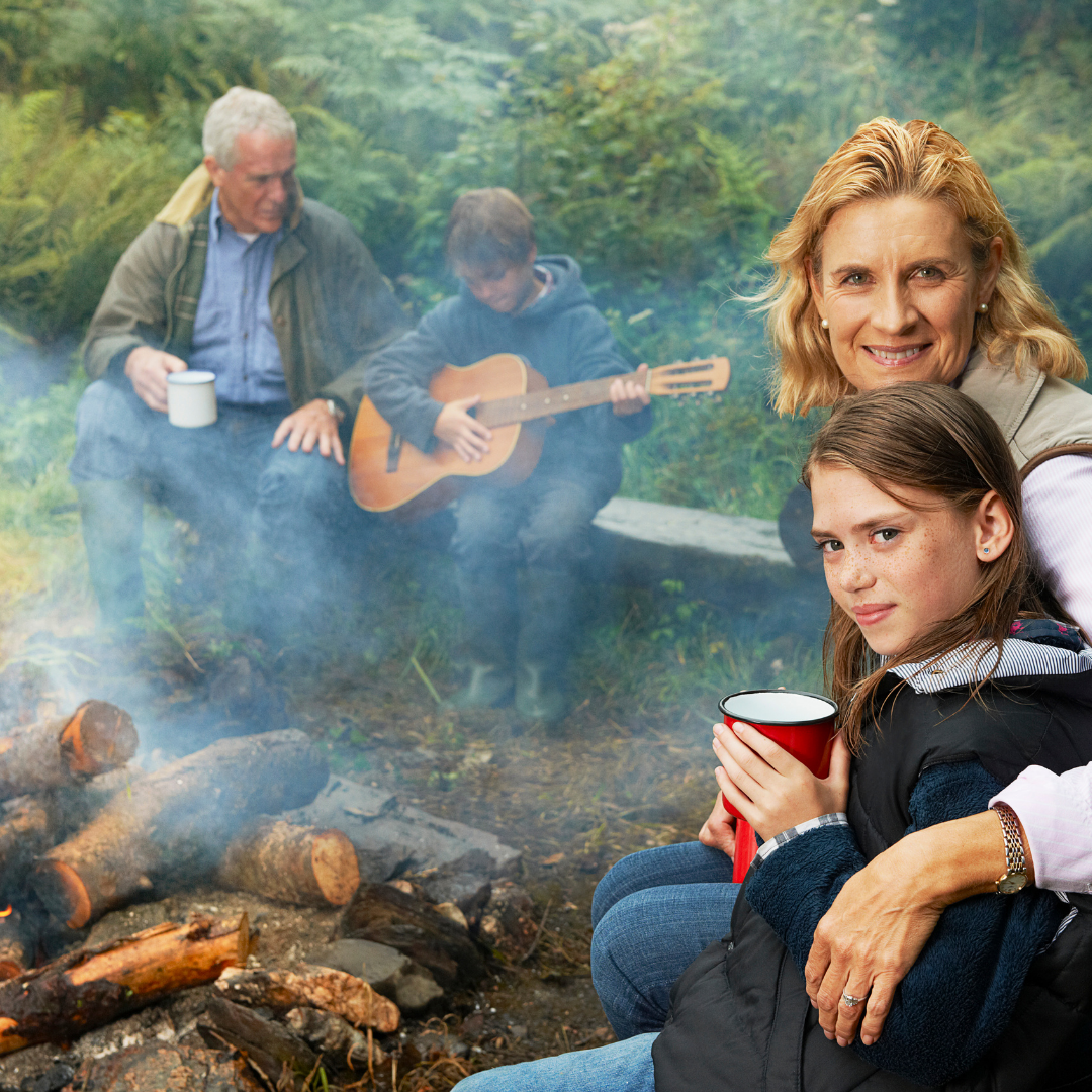 family group sitting round campfire , bo