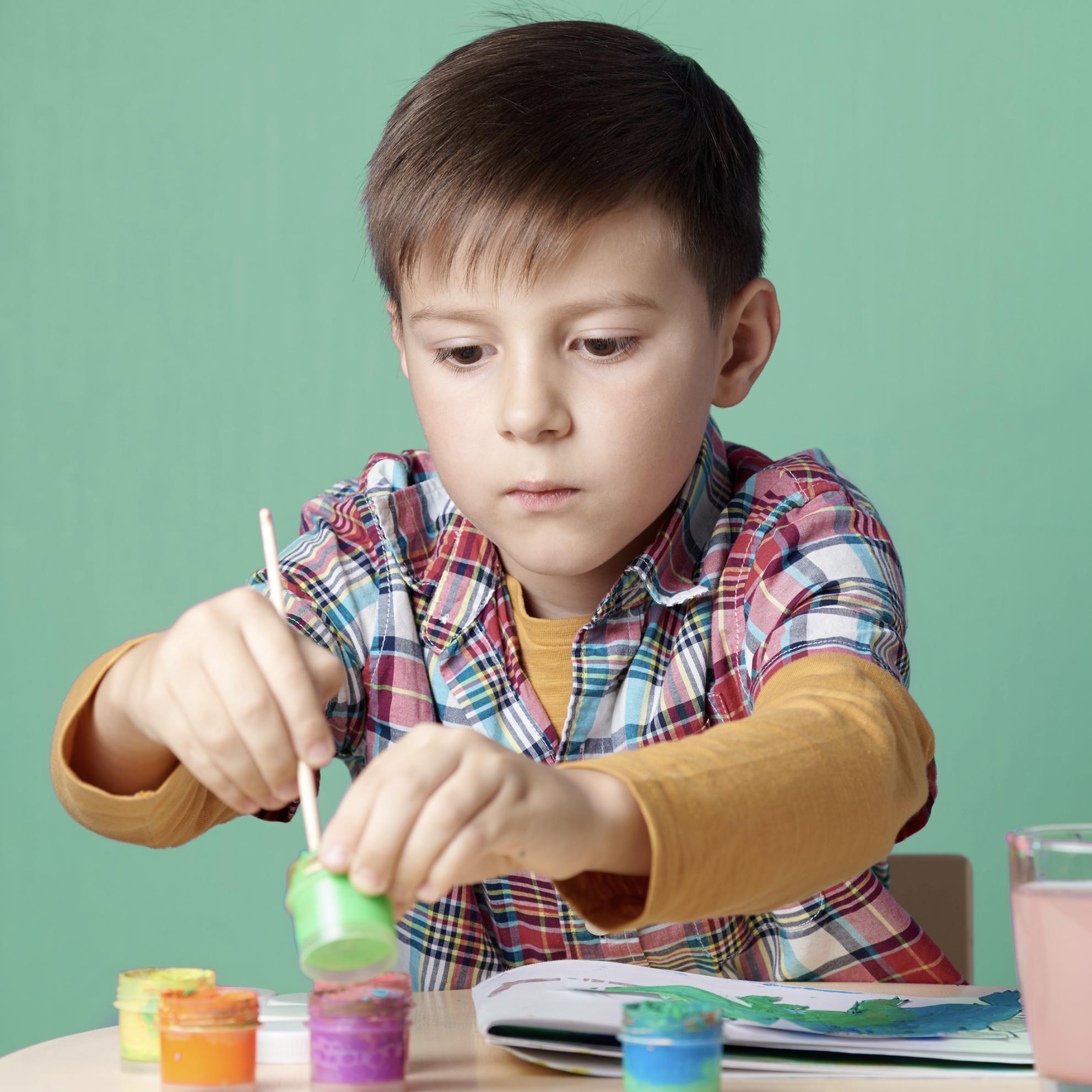 Happy kid painting