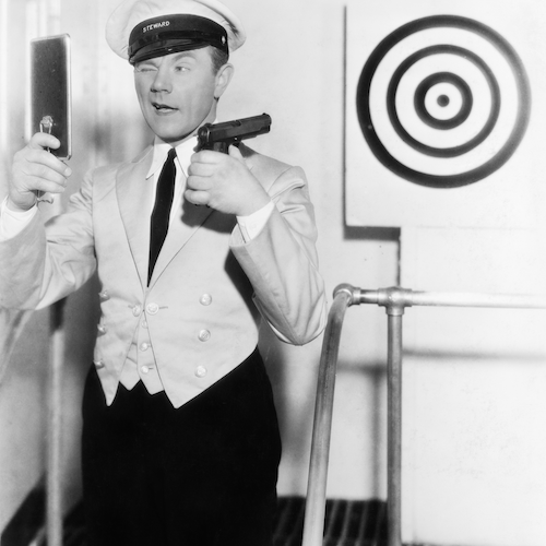 comedy image of ship steward attempting to hit a target using a mirror to fire gun over shoulder