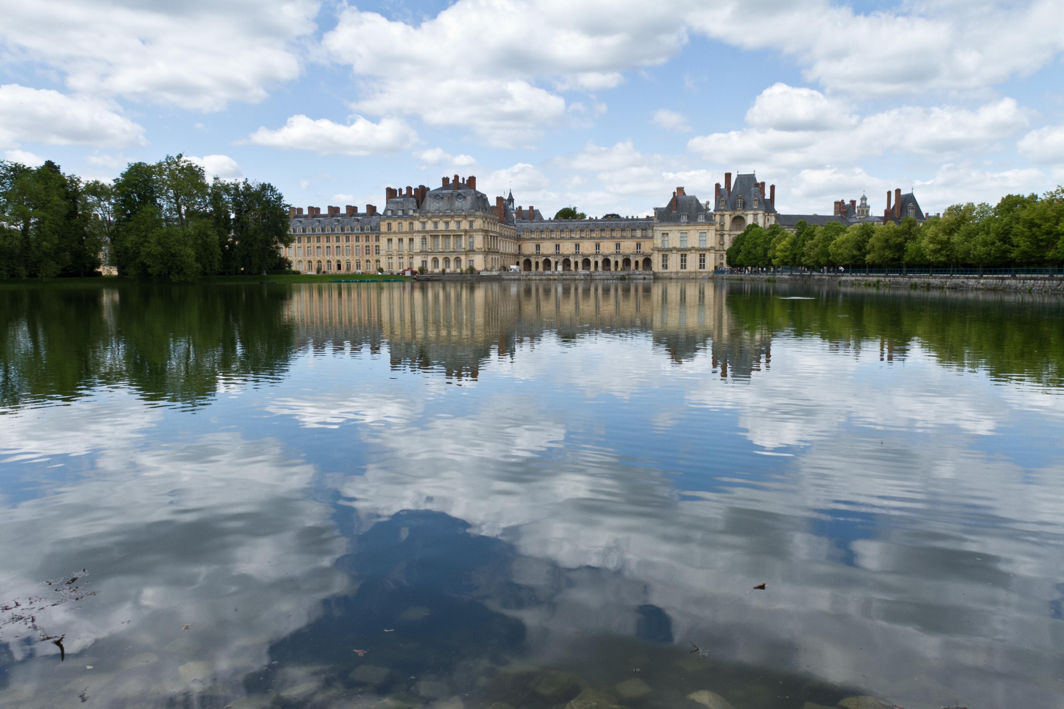 French villa reflection in lake