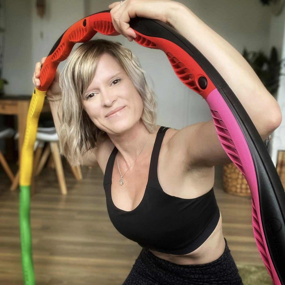Woman at home with her Powerhoop