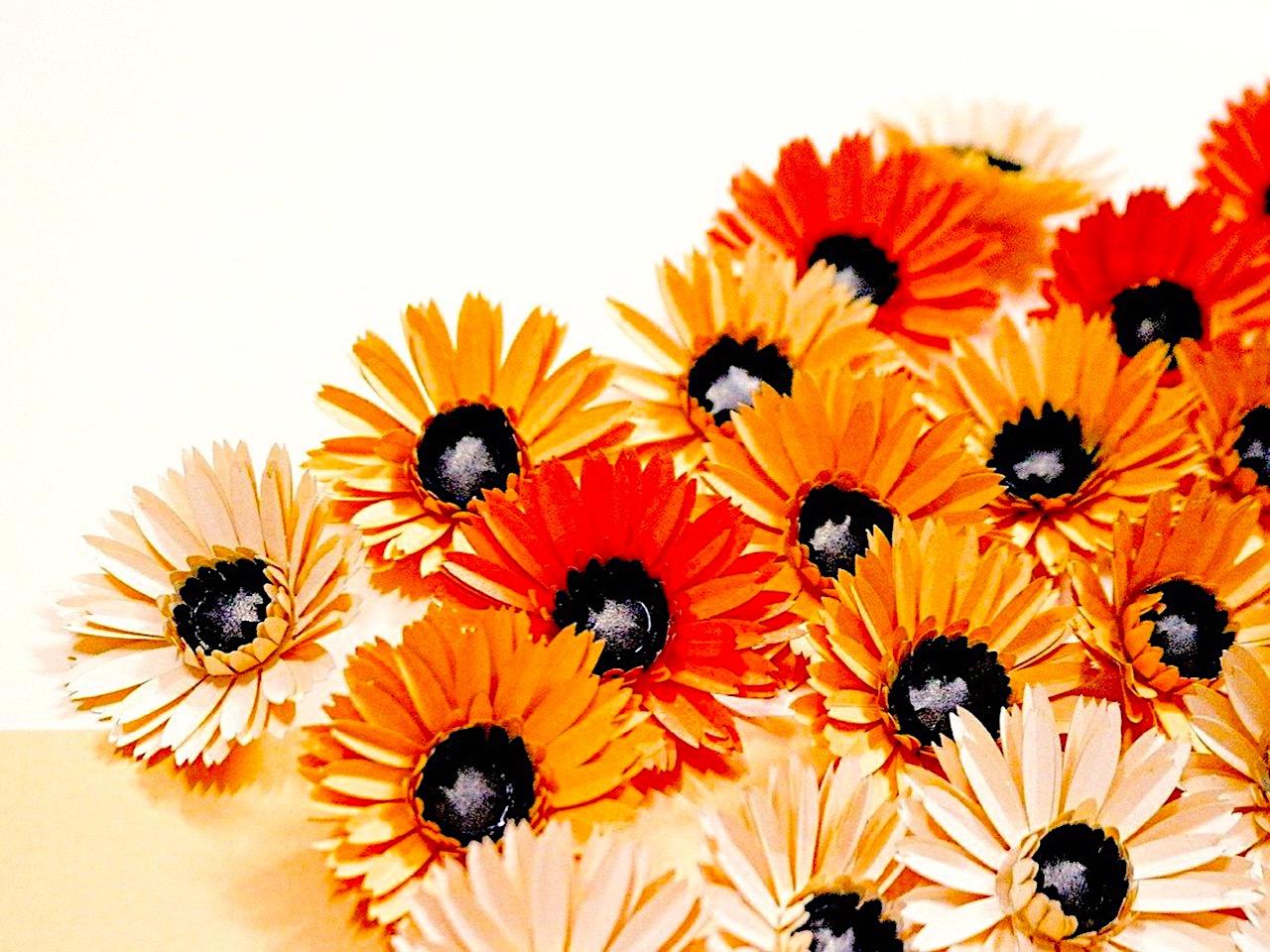 Bright orange and cream paper flowers