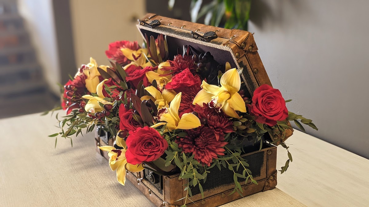 Suitcase full of fall flowers