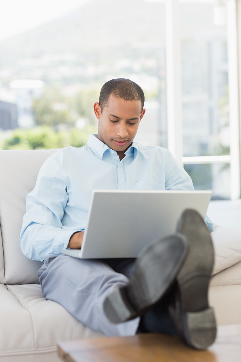 A business owner kicking back and relaxing while leads pour through his website
