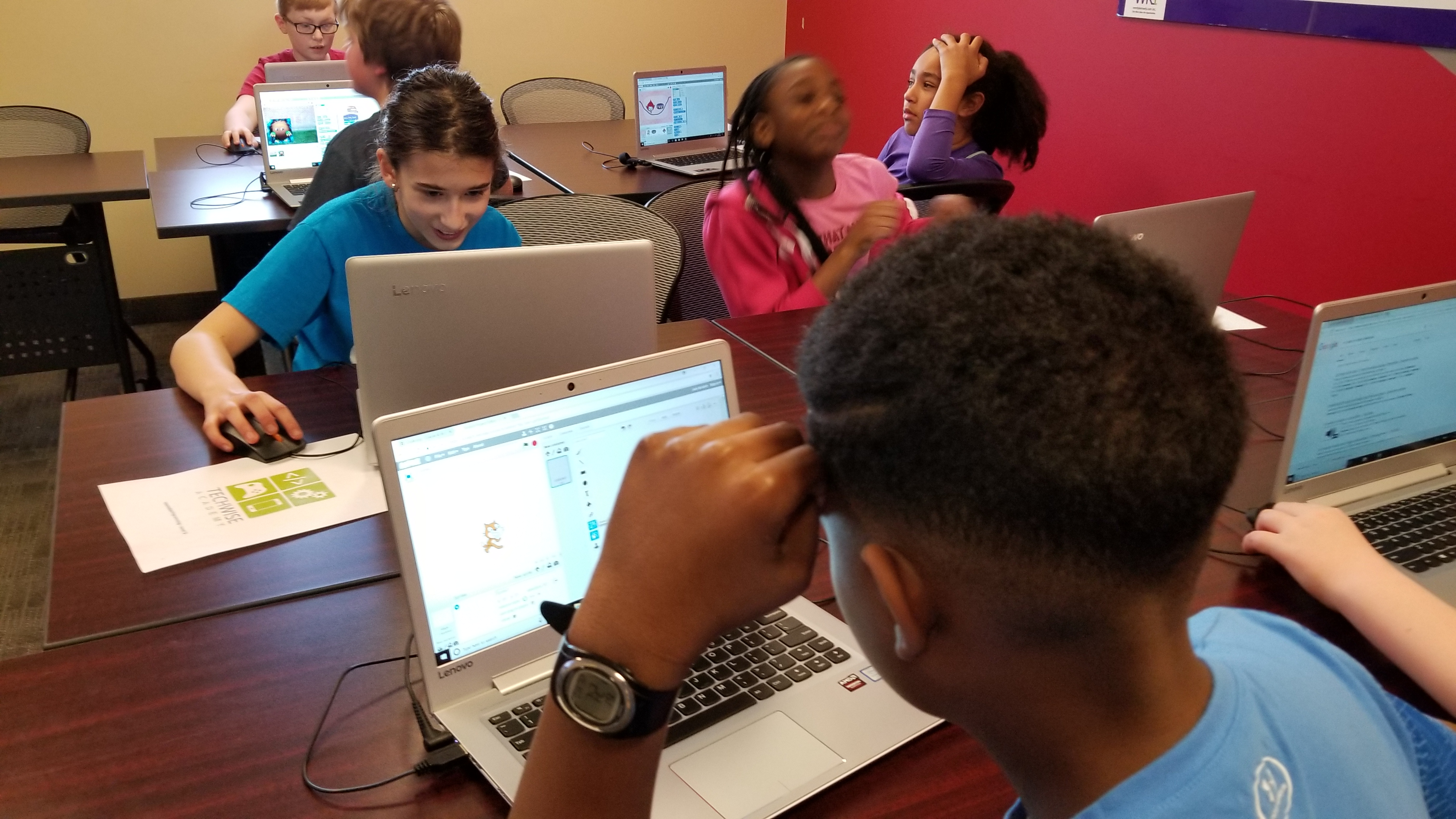 Students working in Scratch