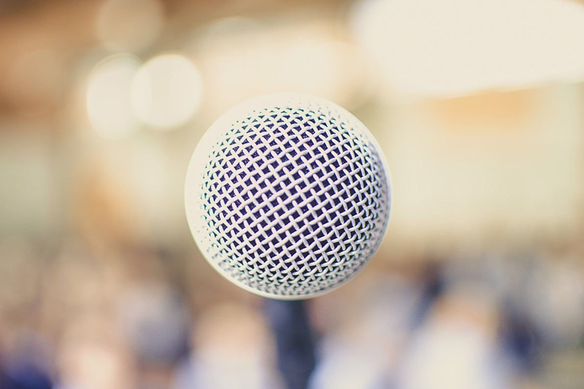 white microphone with pale blurry background