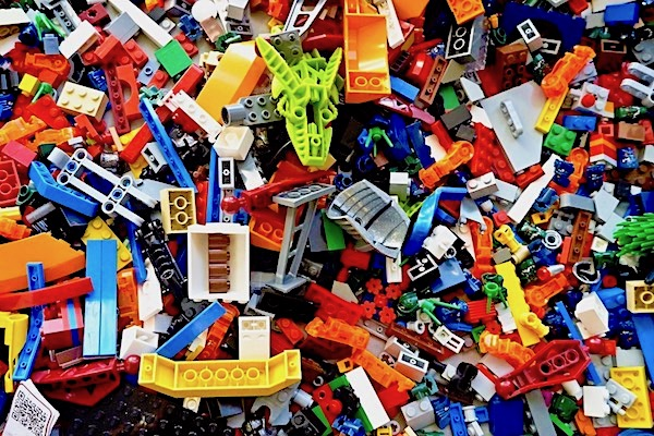 A mixture of children's small building bricks jumbled tote