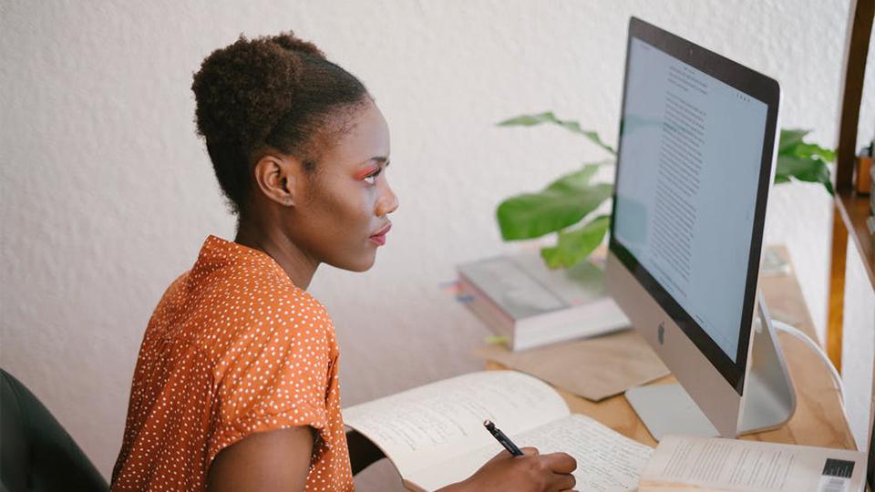 A women reading a computer screen
