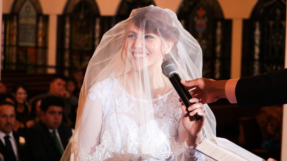 microphone and arm in front of bride