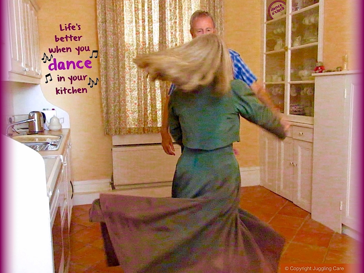 Man and woman dancing in a kitchen