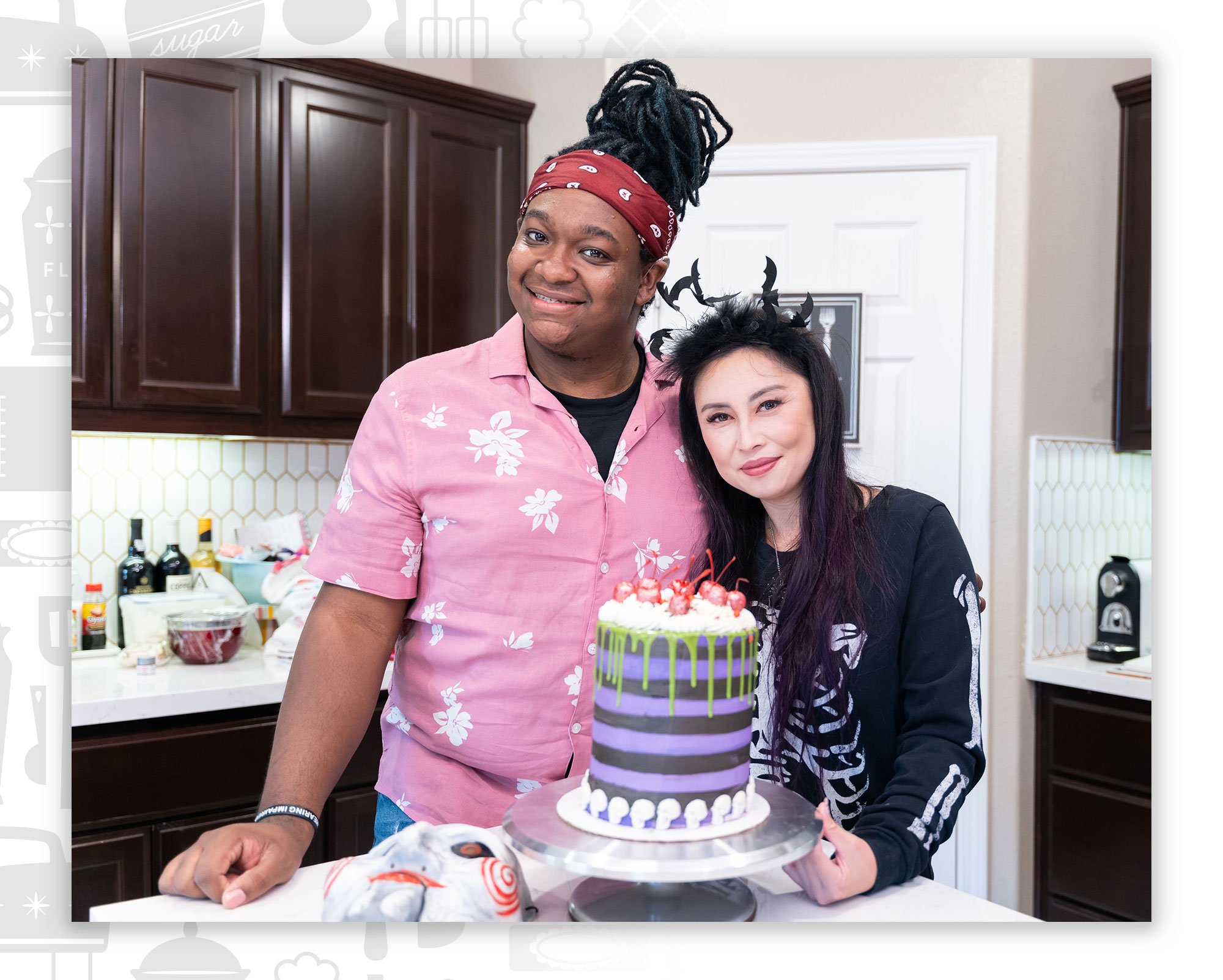 Malek and Lisa posing with a cake for Baking with Borderlands