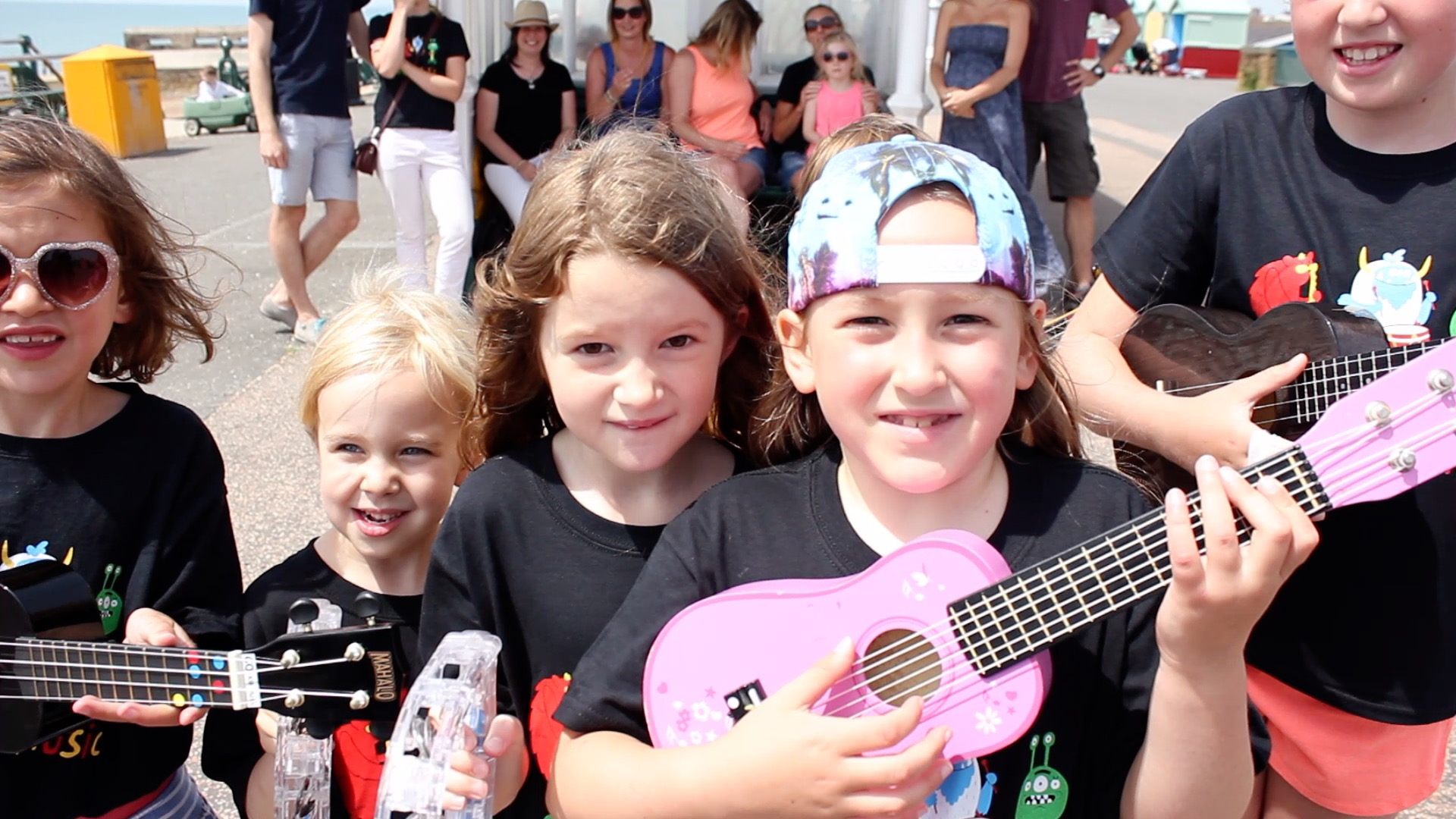 group of children with ukuleles