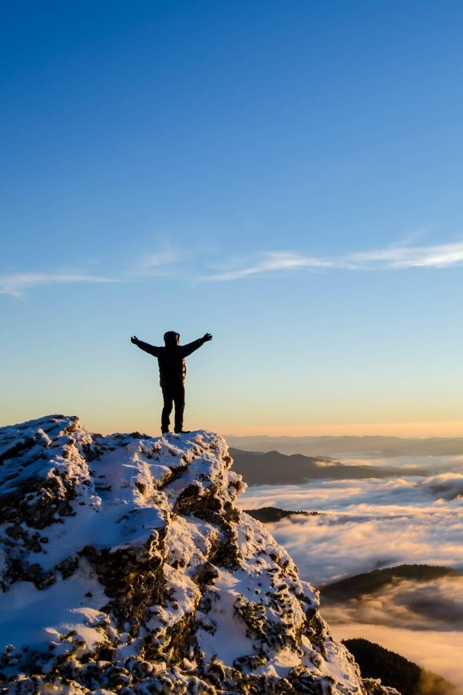 hiker feeling great on a mountain