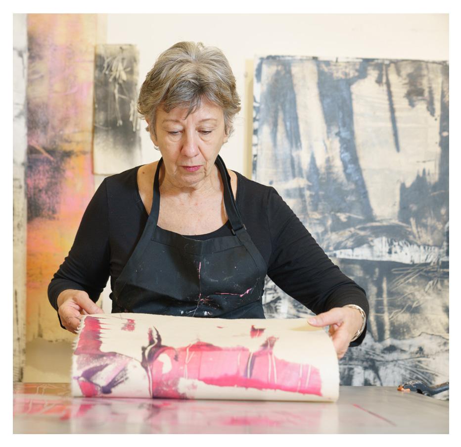 Paula Roland making an encaustic monotype