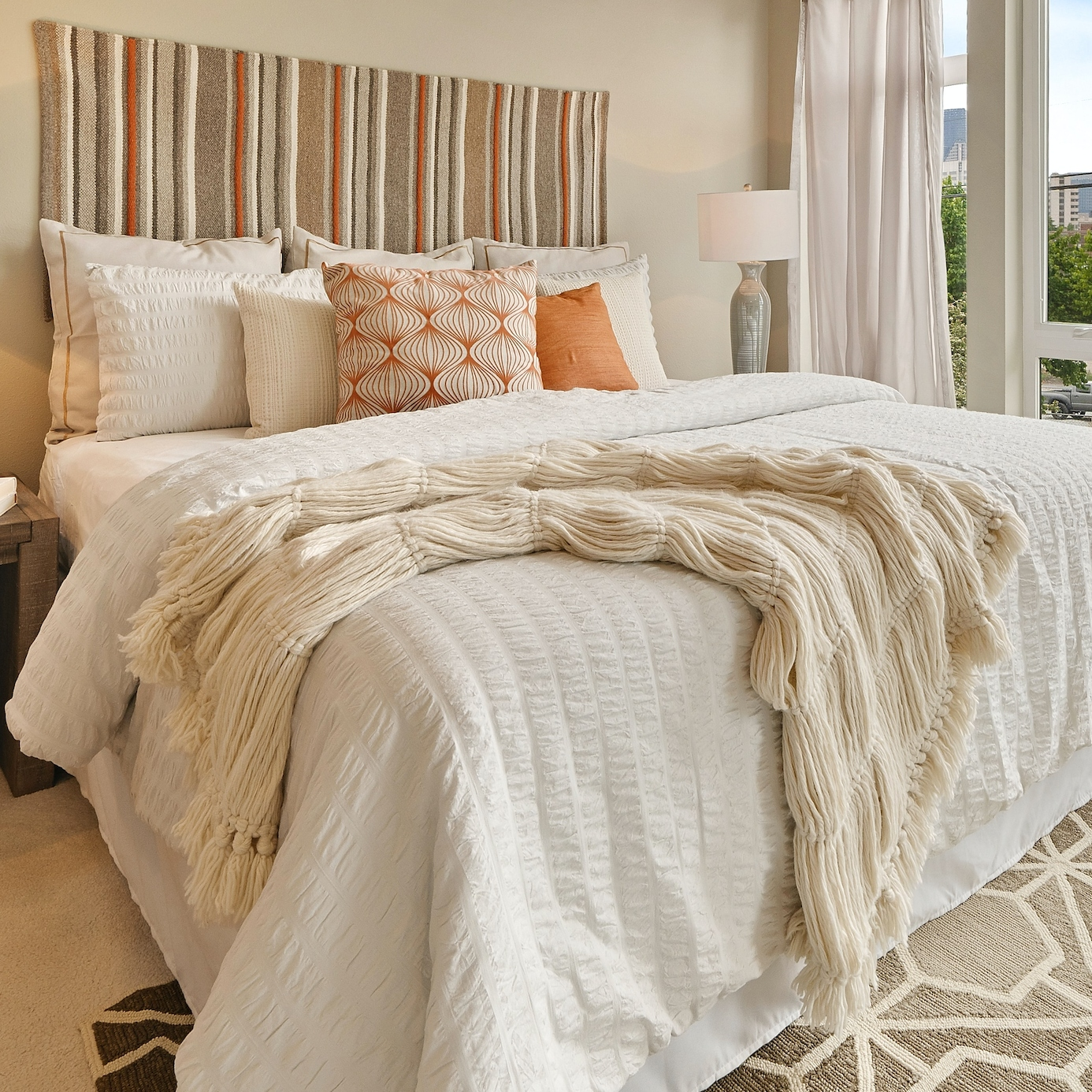 Bed Decorated with White and Orange Colors