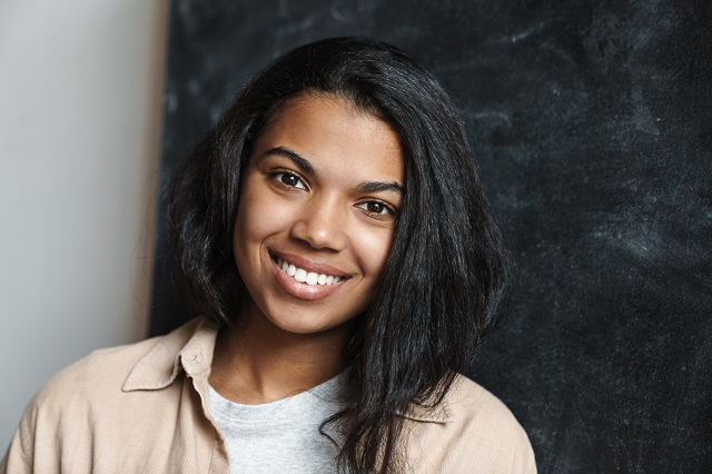 smiling woman with black background